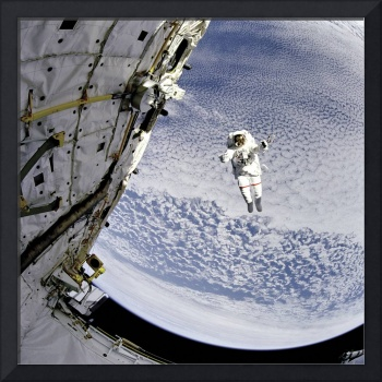 Astronaut Mark C. Lee with Earth in Background