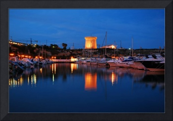 El Campello tower reflecting in the port at night