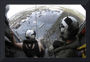 US Navy Search and Rescue crewmembers look on from