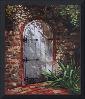 Decorative door in archway set in stone wall surro