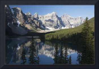 Mountain Range And Lake Reflection With Blue Sky