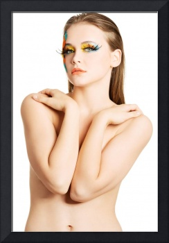 Beautiful woman with abstract artistic make up.