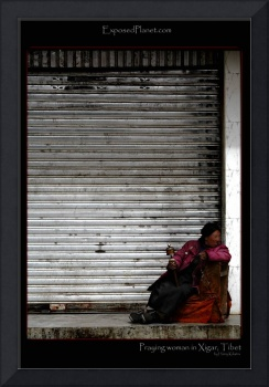 Praying woman in Xigar, Tibet
