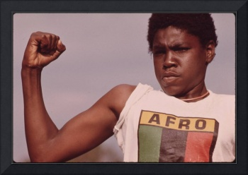A Young Black Man Showing His Muscle During A Smal