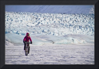 Woman Fat Tire Mountain Biking On The Knik Glacier