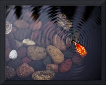 Pond with toy goldfish