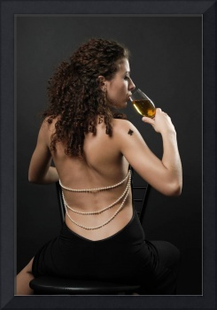 Rear view of sexy girl drinking wine