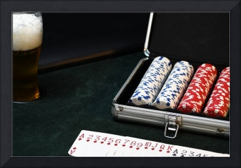 Poker Chip Set Next To Cards And A Cold Beer