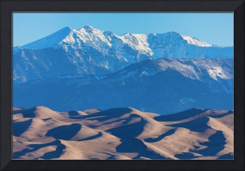 Snow Covered Rocky Mountain Peaks with Sand Dunes