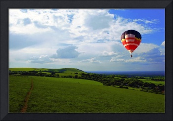 A Balloon flies over Sussex Downs National Park