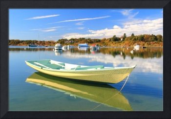 Yellow wooden rowboat on Chatham Harbor