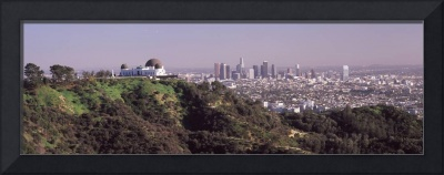 Observatory on a hill with cityscape in the backg