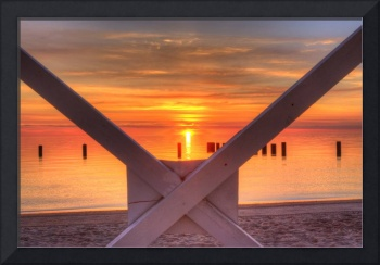 Sunrise under the a lifeguard chair