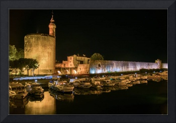 Boats moored in Medieval harbour of  Aigues-Mortes
