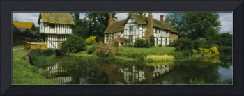 Reflection of a cottage in water