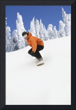 Snowboarder Going Down Snowy Hill