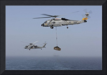 A SH-60J Seahawk and a MH-60S during a vertical re