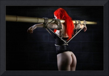 Tied to bamboo tube - Fine Art of Bondage