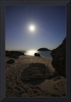 A full moon skyscape over a small beach called Por