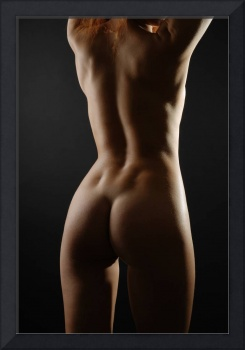 Rear view of nude woman, low key