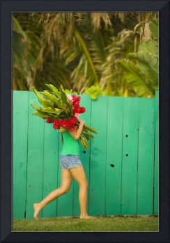 Teenage girl holding red and pink ginger flowers