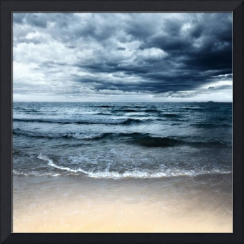 Sandy beach at stormy day. Dramatic sky