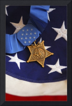 The Medal of Honor rests on a flag during preparat