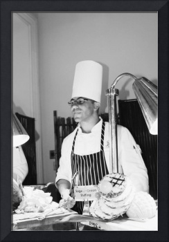 The Serving Chef In Black and White