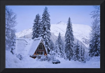 Scenic winter view of an A frame home with the Chu
