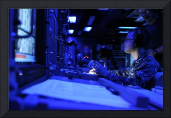 Sonar Technician stands watch in the combat inform