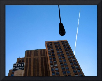 Urban Sky: Broadway Streetlight Contrail