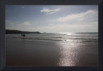 Surfing in the sun light on Fistral Beach