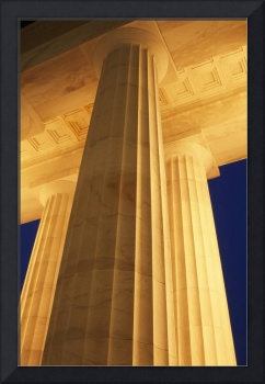 Low-angle view of Lincoln Memorial columns illumi