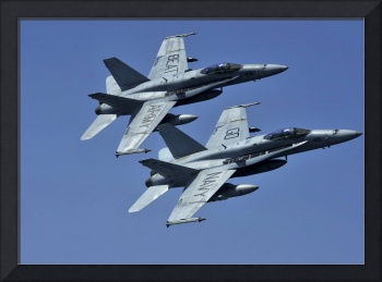 Two F/A-18C Hornets in flight