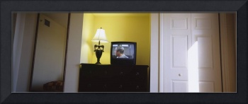 Television and lamp in a hotel room