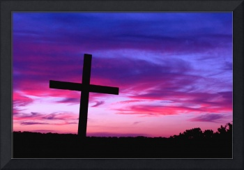 From Above: Cross Silhouetted by a Colorful Sunset