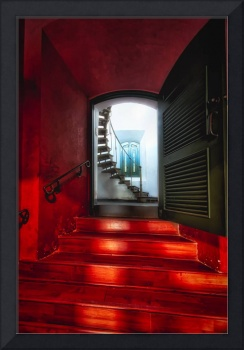 Red Doorway to a Spiral Staircase