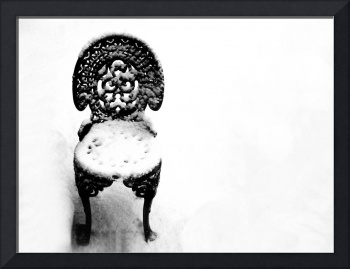 Black Metalwork Chair in the Snow