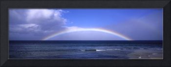 Full Rainbow Over Ocean, Large Clouds Against Blue
