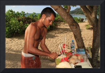 Native carving coconuts