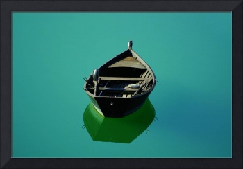 Small boat at mirror
