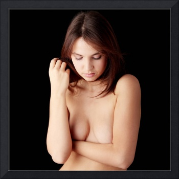 Nude female, covering her body with hands.