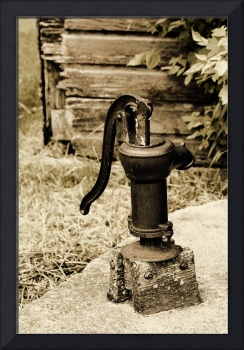 Antique Water Pump on a Concrete Cistern