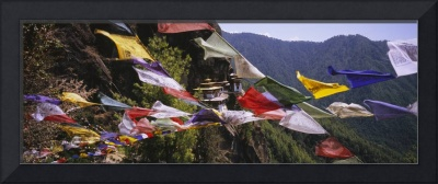 Prayer flags in front of a monastery on a mountai
