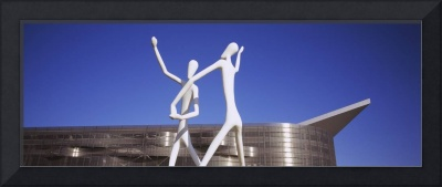 Dancers sculpture by Jonathan Borofsky in front o