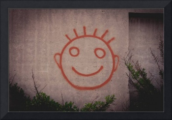 Graffiti painting of red happy smiley face