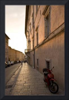 Moped in street at sundown in Assisi