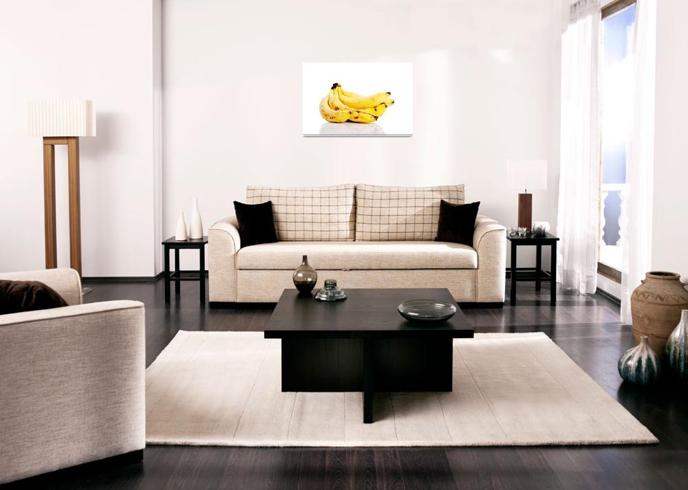 """Yellow bananas lying on white background.""  by Piotr_Marcinski"