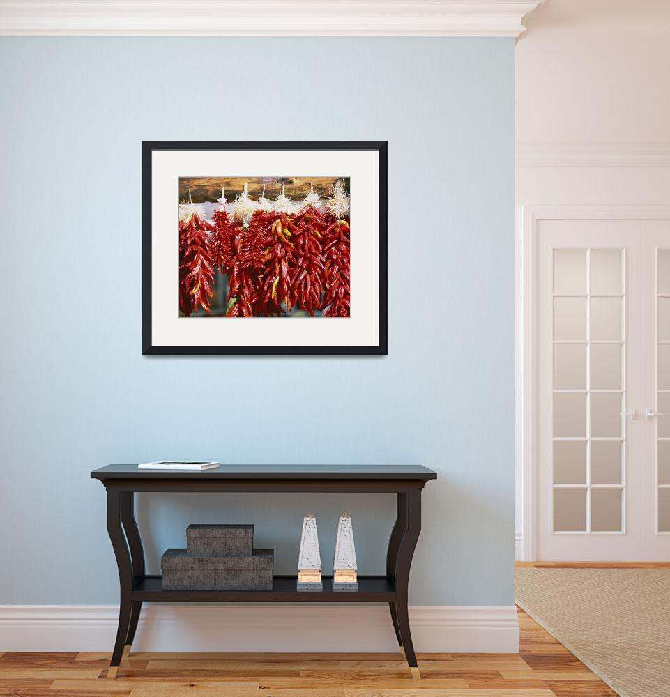 """Red chili peppers hanging on a log&quot  by Panoramic_Images"