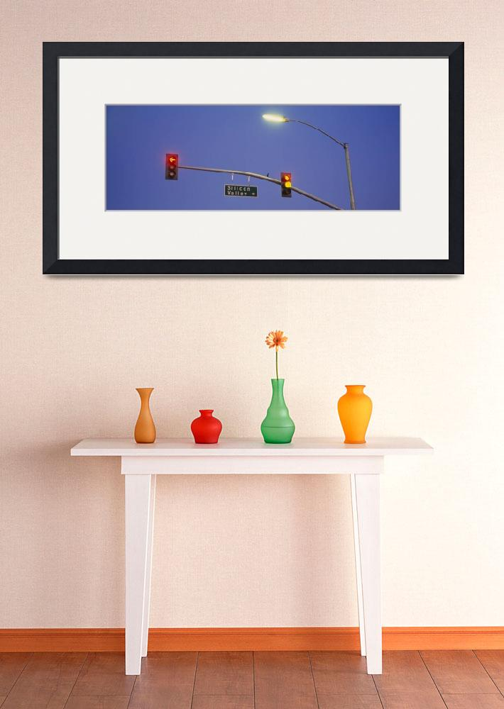"""""""Low angle view of traffic lights and a street sig&quot  by Panoramic_Images"""